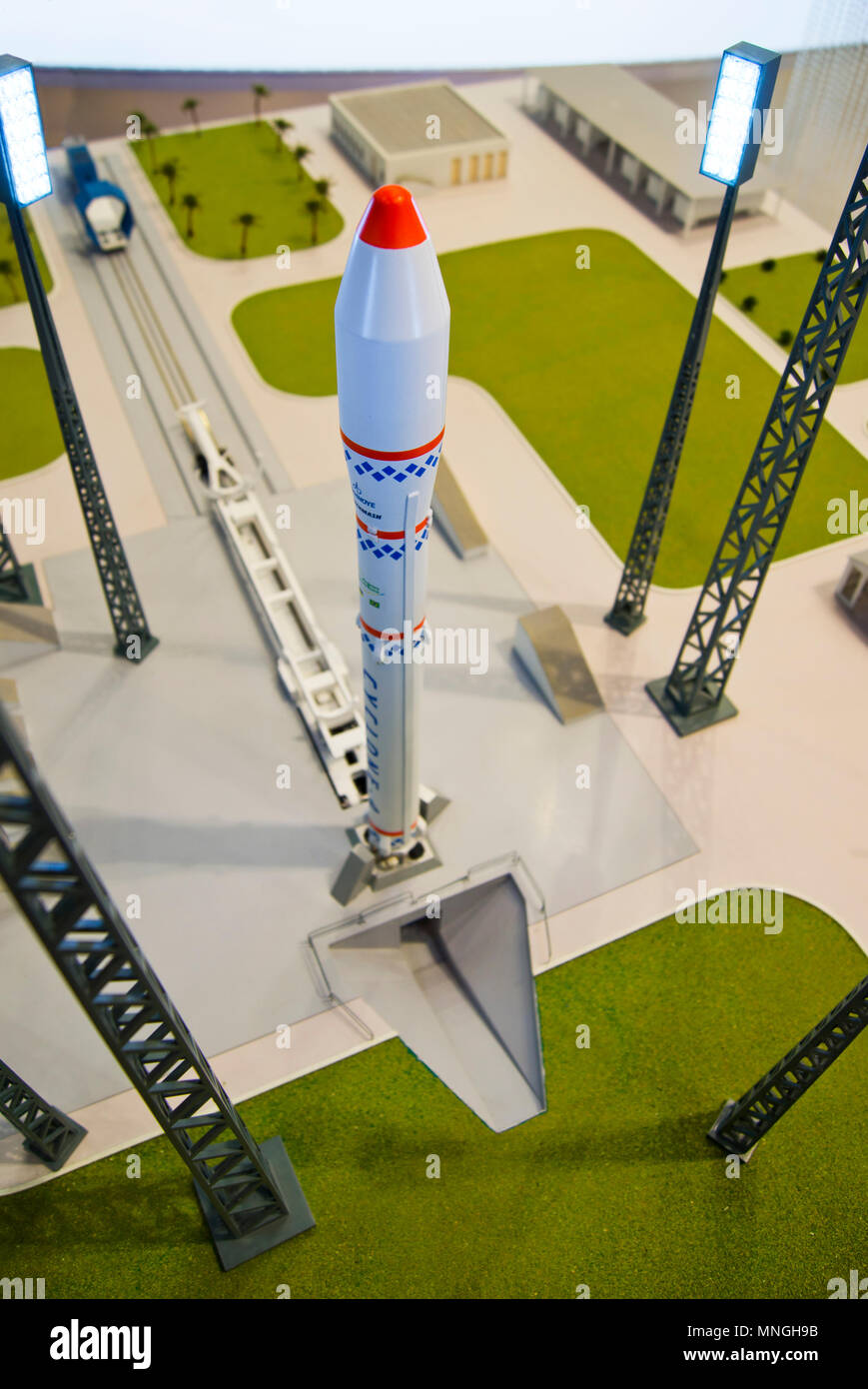 A model of the Russian Cyclone rocket and its launch pad displayed at the 64th IAC in Beijing, China. - Stock Image