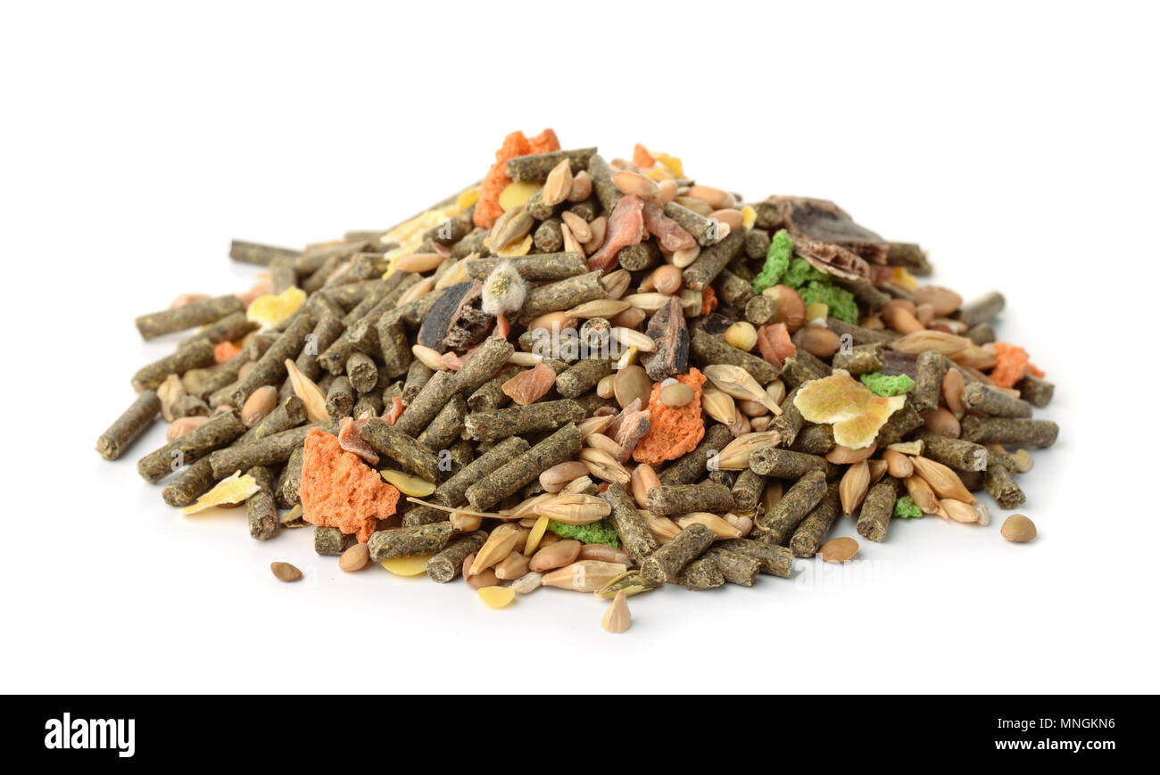 Pile of dry compound rodents feed isolated on white - Stock Image
