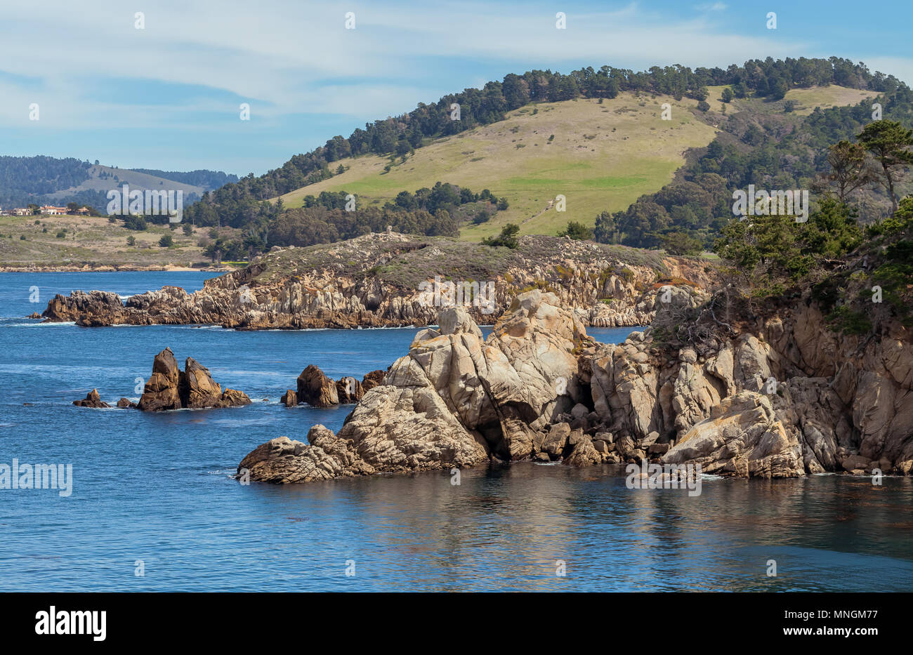 View of the Northern California coastline from Cypress Cove in Point Lobos State Natural Reserve, Camel, United States. Stock Photo