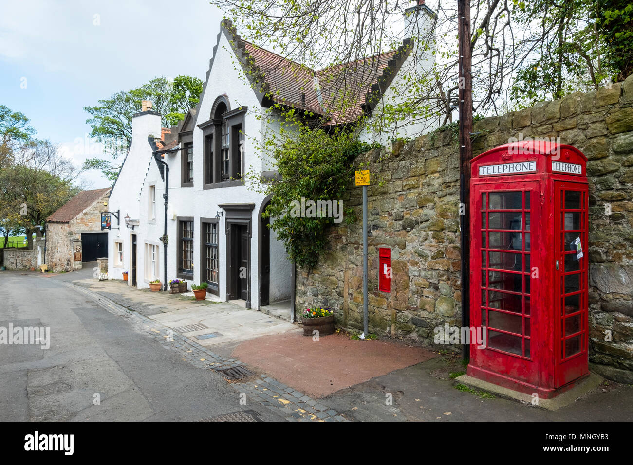 The Cramond Inn and red telephone box in village of Cramond in Edinburgh, Scotland, UK - Stock Image