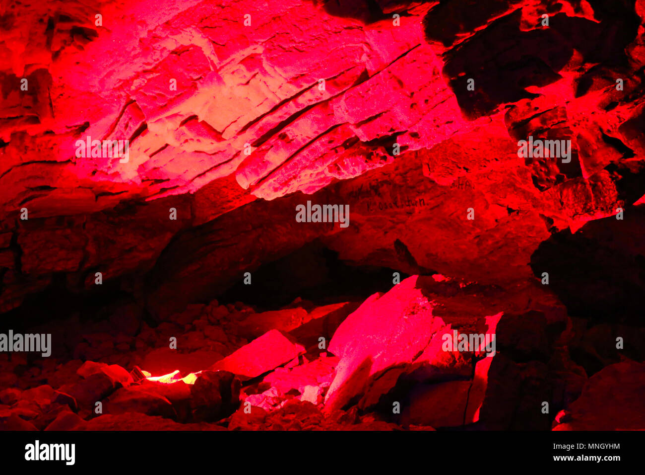 Gypsum cave, anhydrite, sulfate, Anhydrite rocks from cave ceiling, gypsum cave, anhydrite, sulfate, carbonate minerals. Kungur cave, artificial light - Stock Image