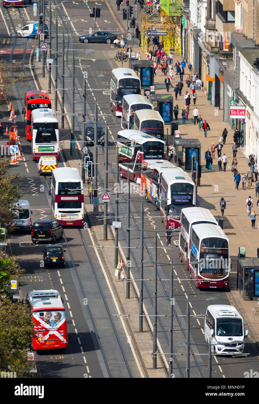 Busy public transport buses  traffic on Princes Street shopping street in central Edinburgh, Scotland, UK - Stock Image