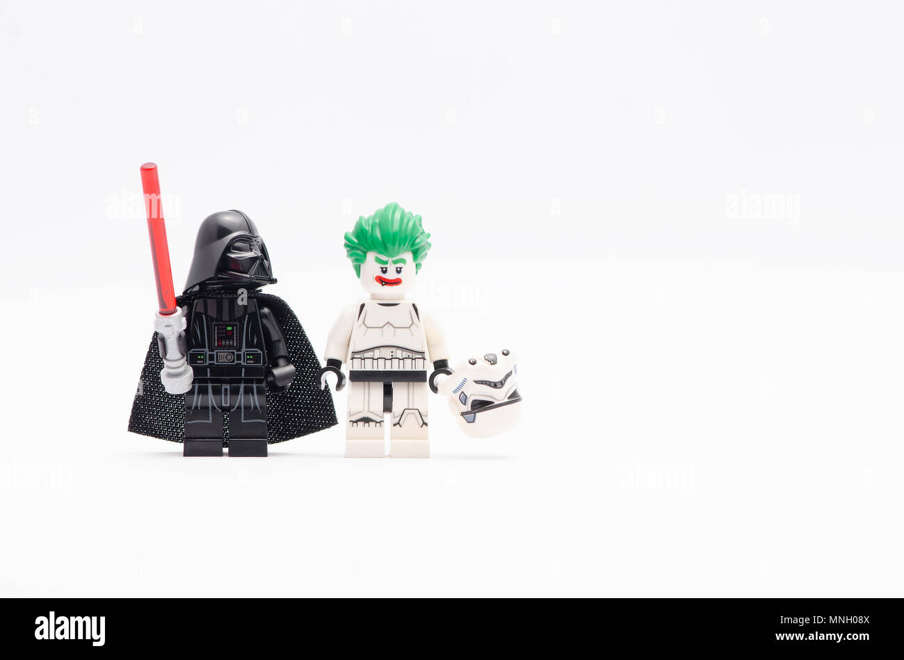 mini figure of  darth vader watching  joker in storm trooper suit . Lego minifigures are manufactured by The Lego Group. - Stock Image