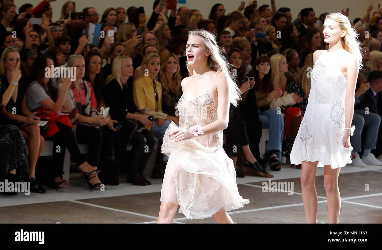 Cara Delevingne fashion model leads in the final run on the catwalk