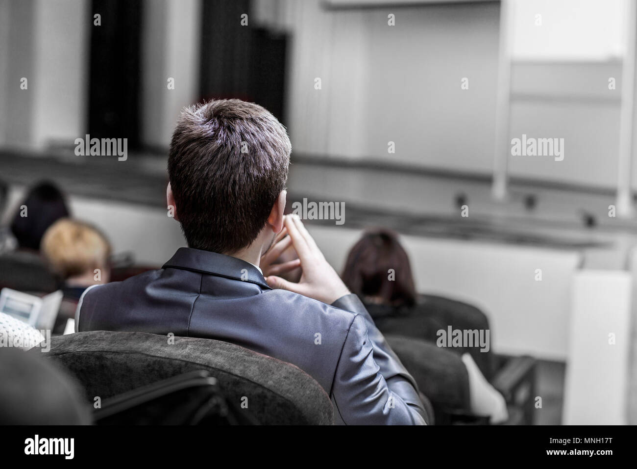students of business courses sitting in the conference room for a business training - Stock Image