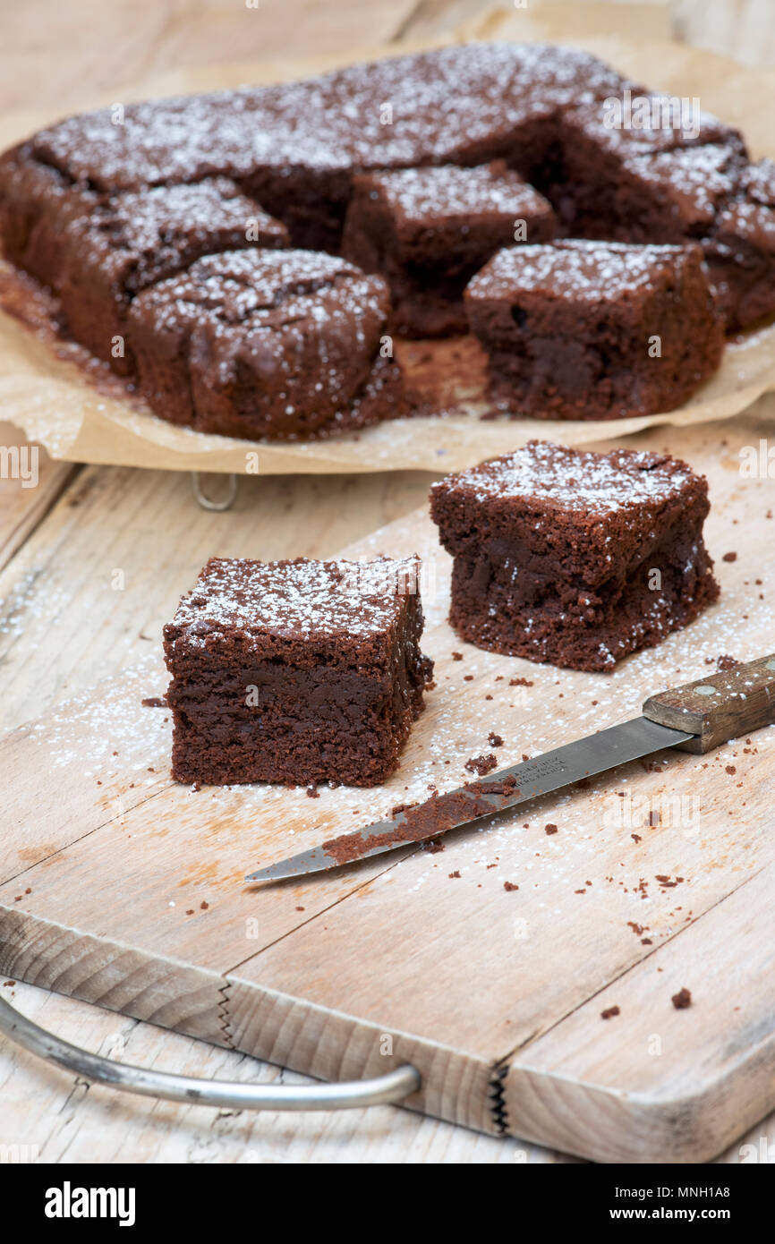 Homemade Chocolate Brownies on a wood background - Stock Image