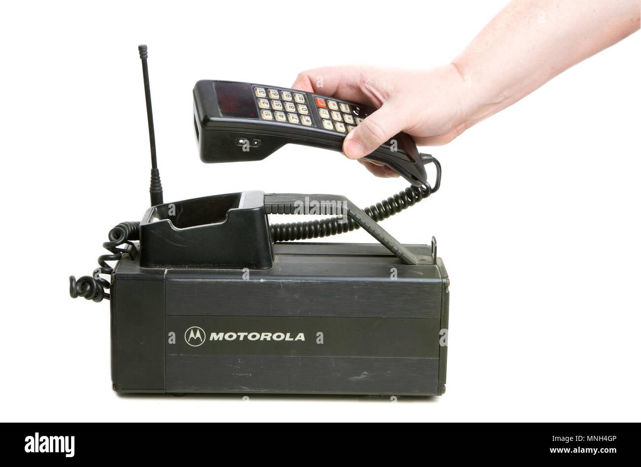 Hallstahammar, Sweden - December 10, 2012: One hand holdning the receiver of a 1980s era Motorola MCR 9500XL mobilephone used in Sweden. - Stock Image