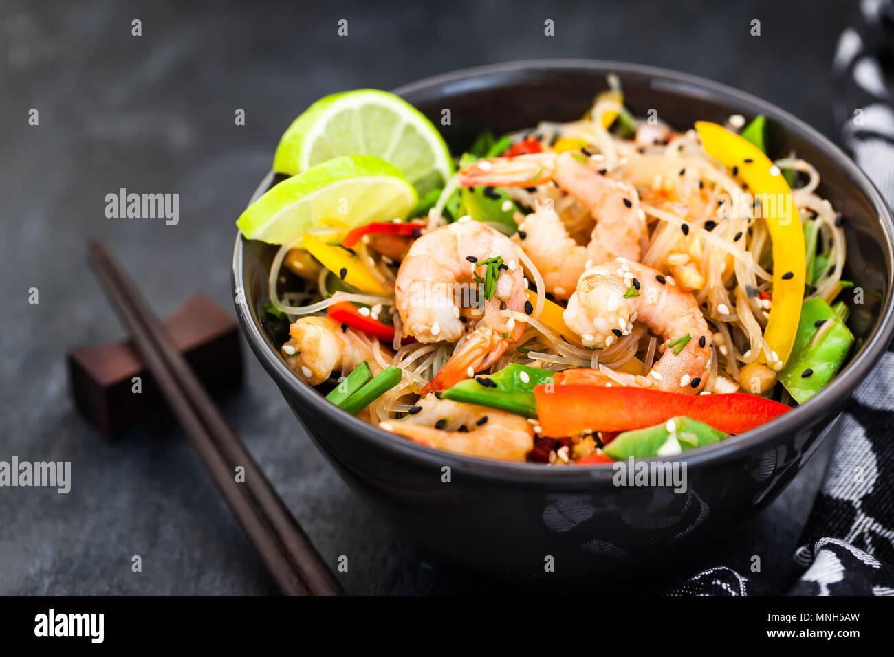 Delicious asian rice glass noodles with prawns and vegetables  (wok) - Stock Image
