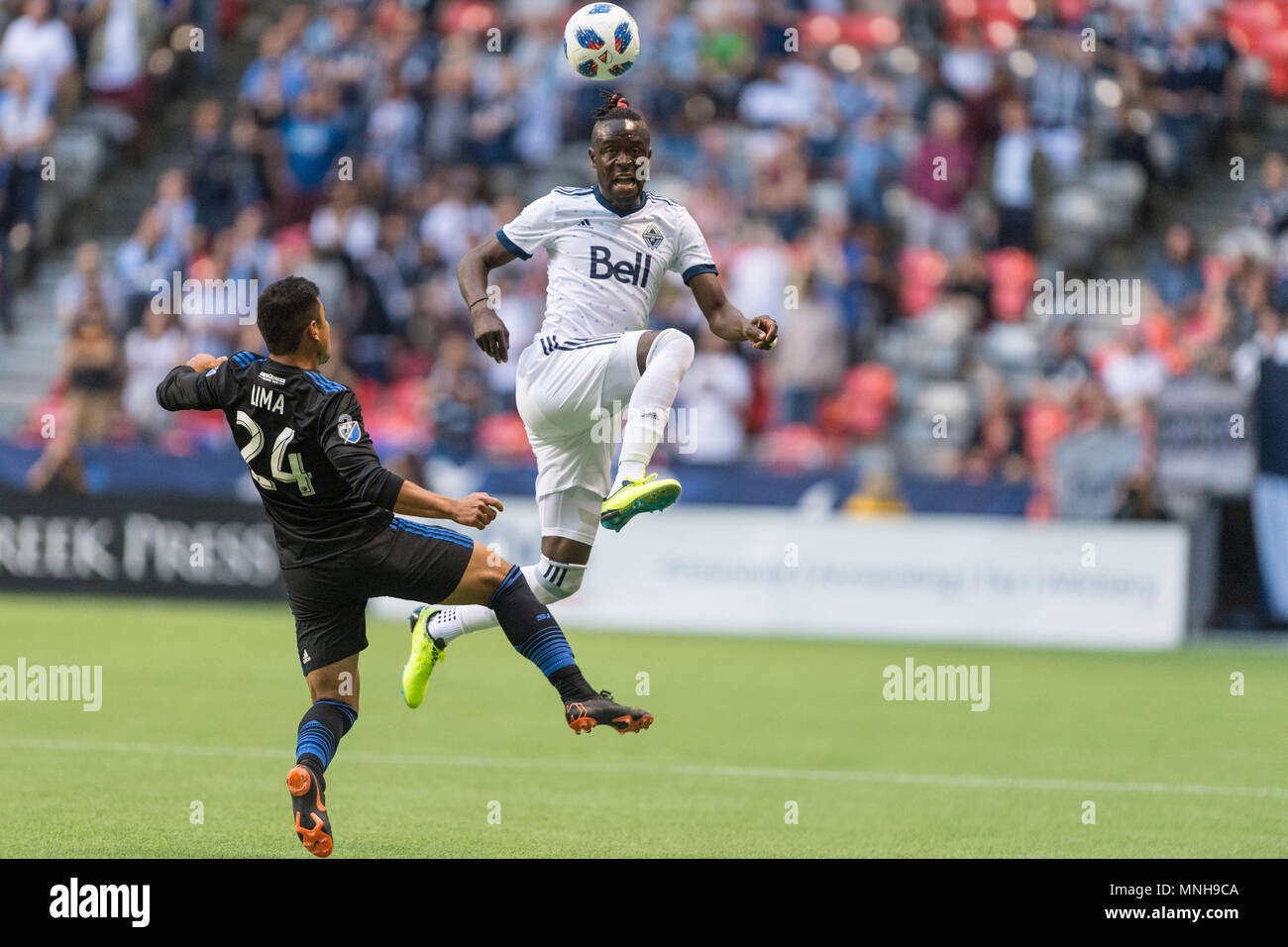 Vancouver, Canada. 16 May 2018. Kei Kamara (23) of Vancouver Whitecaps (right) and Nick Lima (24) of San Jose Earthquakes vie for the ball. Game ends with a 2-2 tie. Vancouver Whitecaps vs San Jose Earthquakes BC Place.  © Gerry Rousseau/Alamy Live News - Stock Image