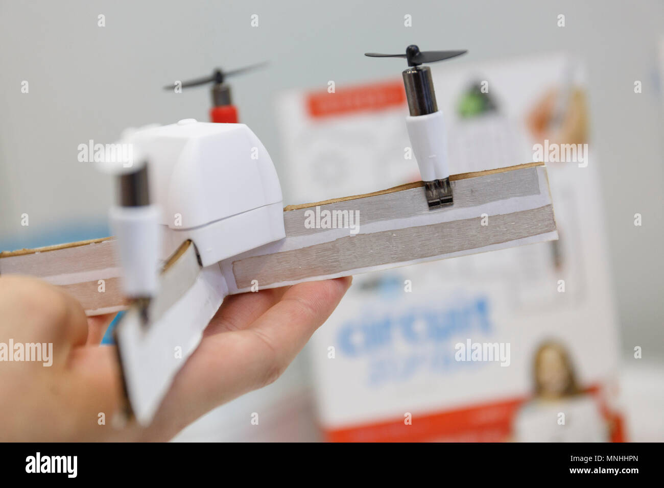 an exhibitor shows a drone painted with a circuit scribe, a