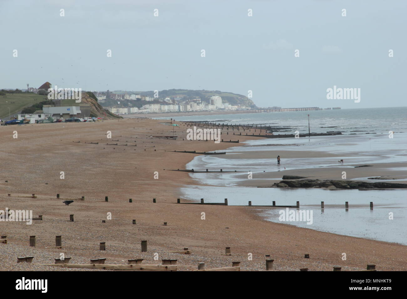 Breakwaters on the beach, Bexhill-on-Sea, Sussex - Stock Image