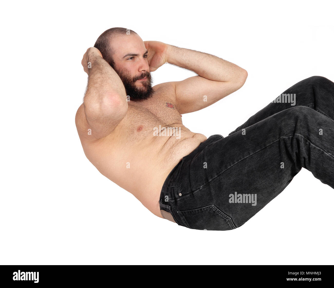 A Slim Handsome Man Without A Shirt And In Jeans Doing Stomach