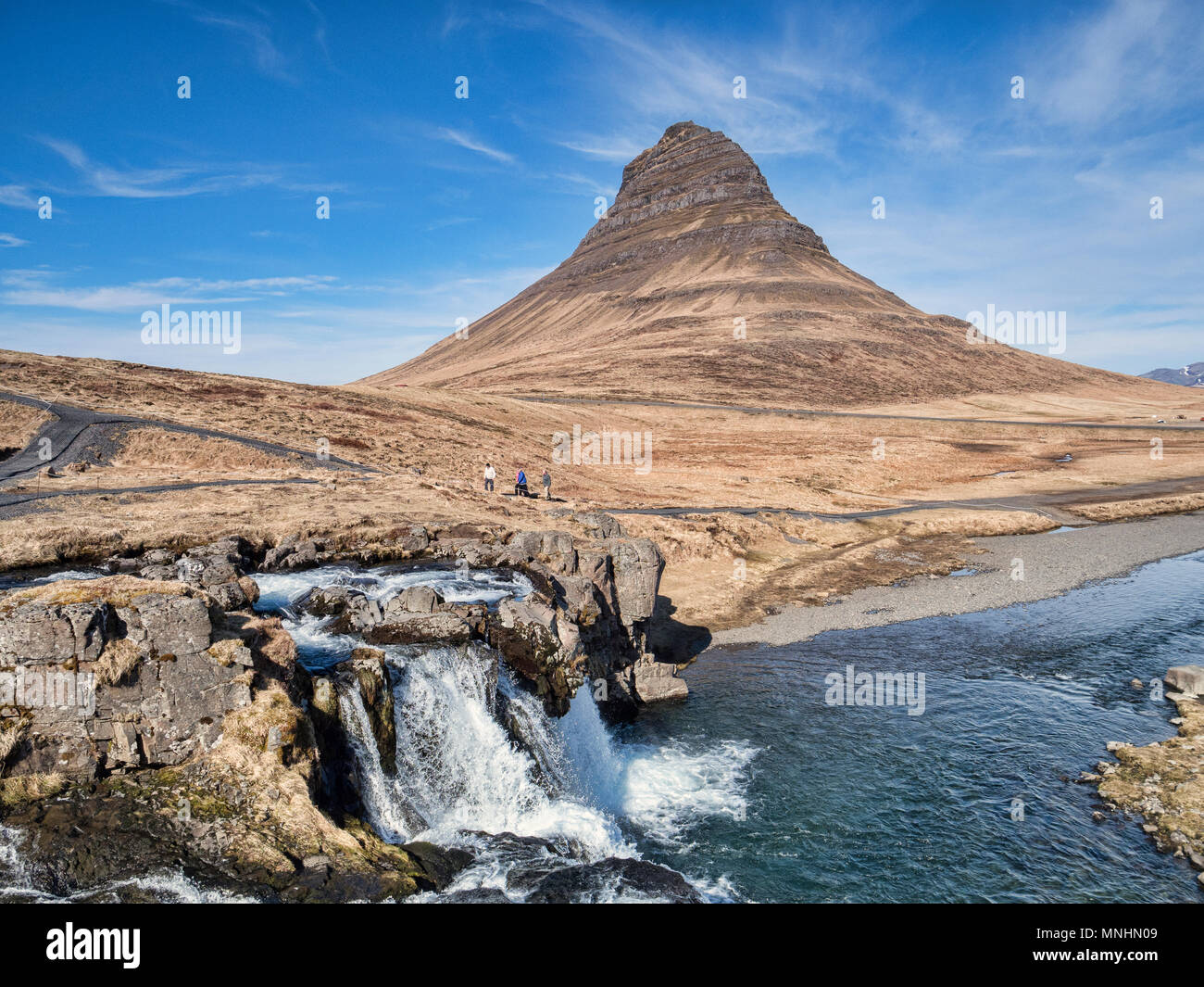 16 April 2018: Snaefellsnes Peninsula, West Iceland - The mountain Kirkjufell and waterfall Kirkjufellsfoss on the Snaefellsnes Peninsula, Iceland... - Stock Image
