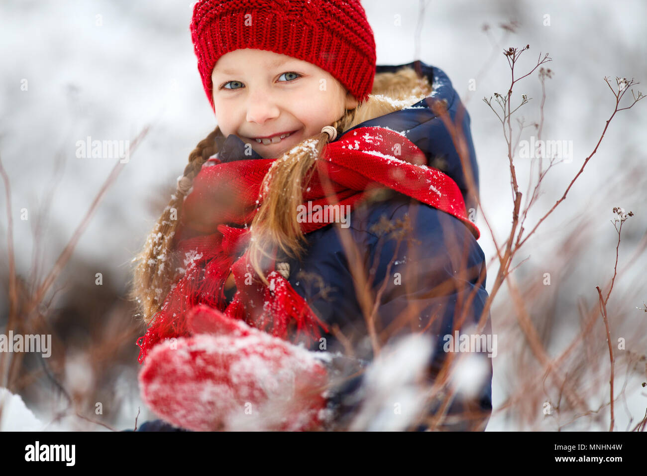 9a6ca351a Adorable little girl wearing warm clothes outdoors on beautiful ...