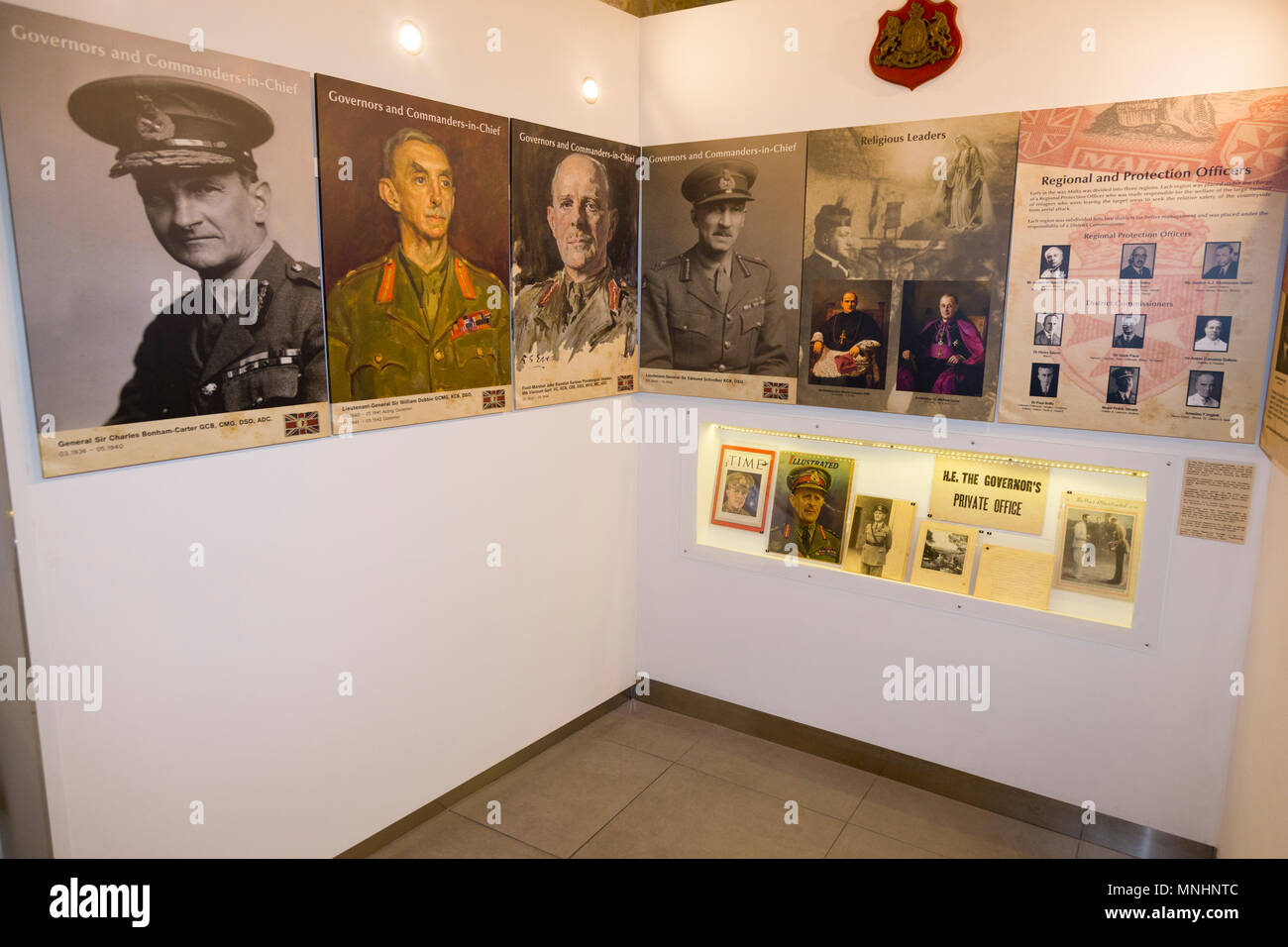 Governors and Commanders in Chief photographs on exhibit wall / display of exhibits inside the exhibition displayed at The Malta At War Museum, Malta - Stock Image