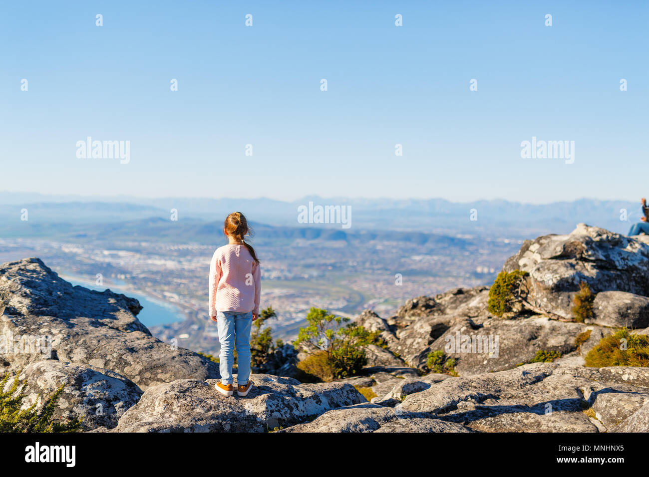 Little girl enjoying breathtaking views of Cape Town from top of Table mountain - Stock Image