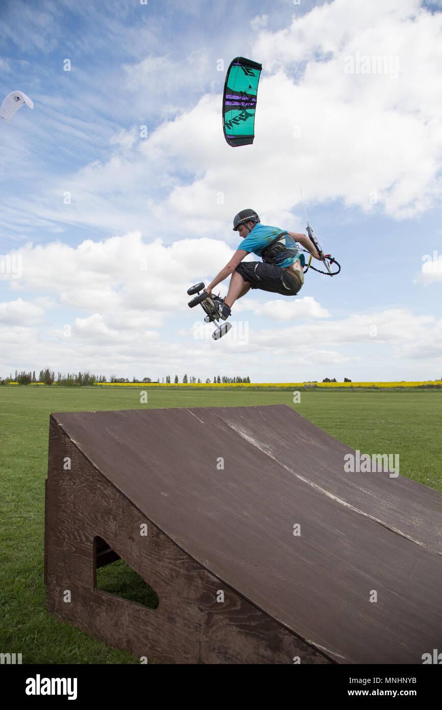 Extreme sport kite landboarding, Essex, UK. Airborne jump. - Stock Image