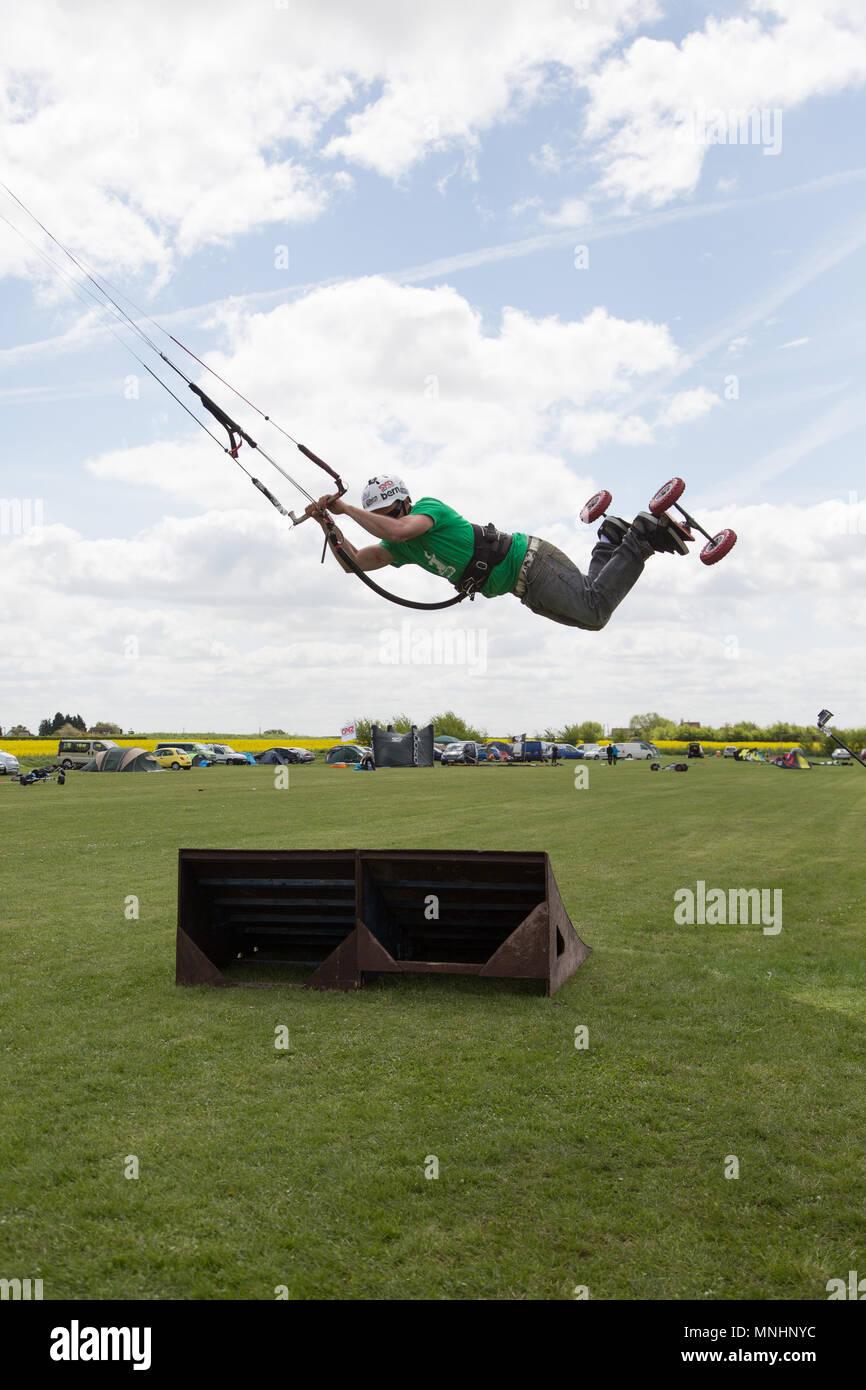 Extreme sport kite landboarding in Essex, UK. Airborne jump. - Stock Image