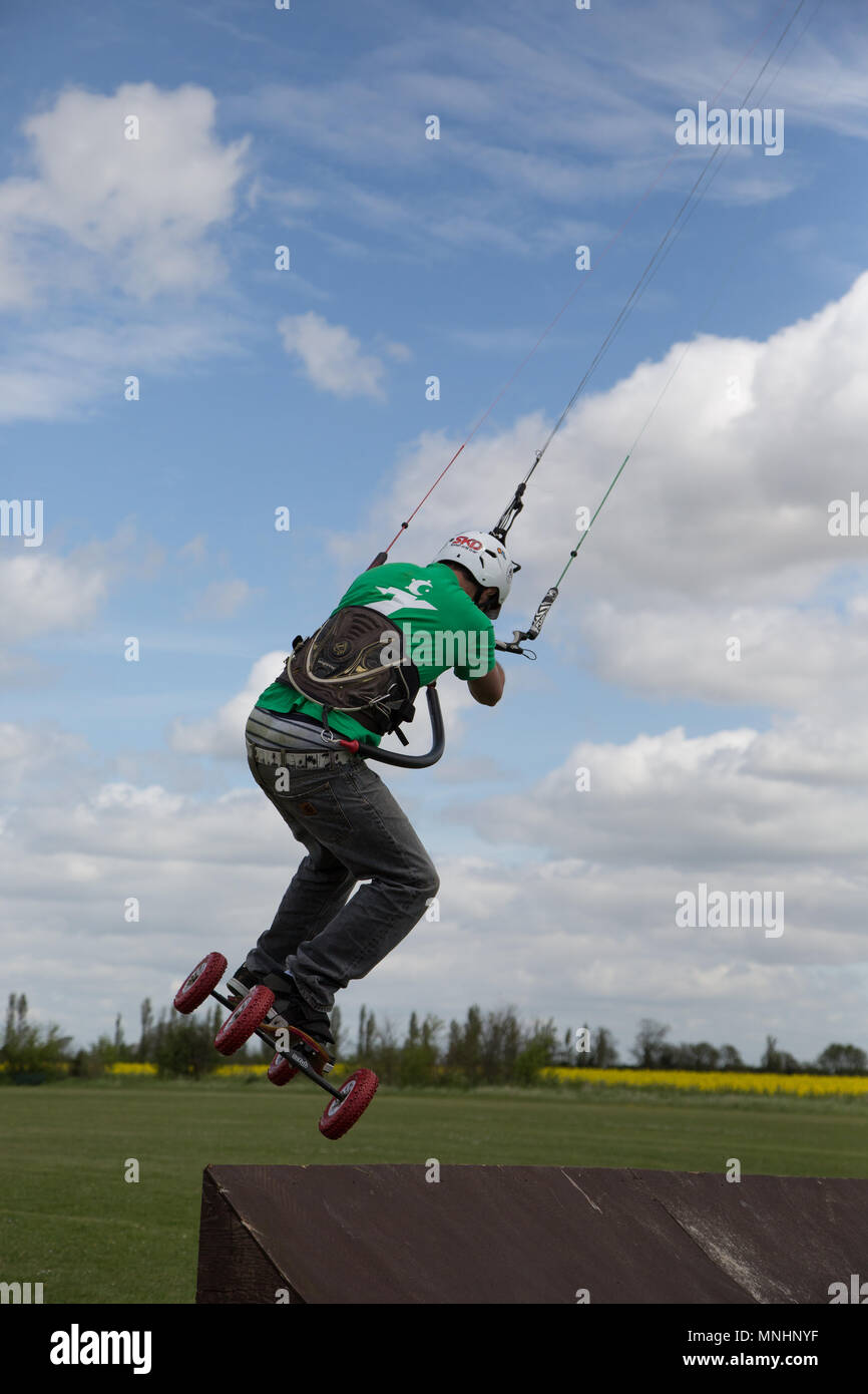Extreme sport kite landboarding in Essex, UK.  About to go airborne. - Stock Image