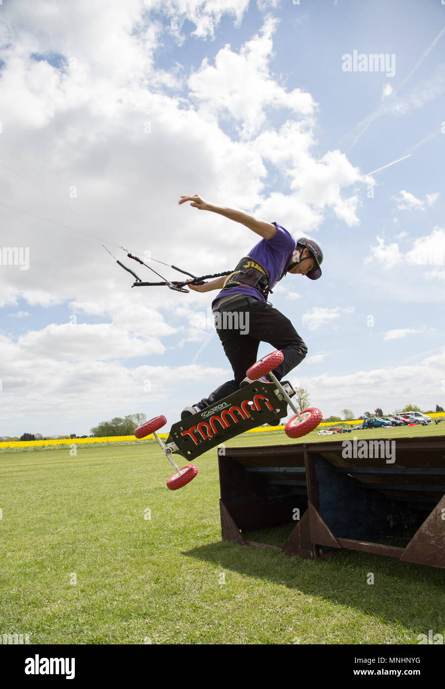 Extreme sport kite landboarding in Essex, UK. Going airborne. - Stock Image