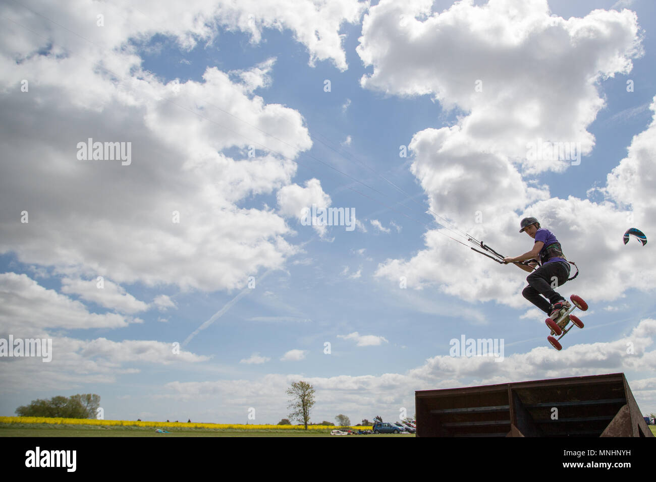 Extreme sport kite landboarding in Essex, UK. Going airborne. Stock Photo