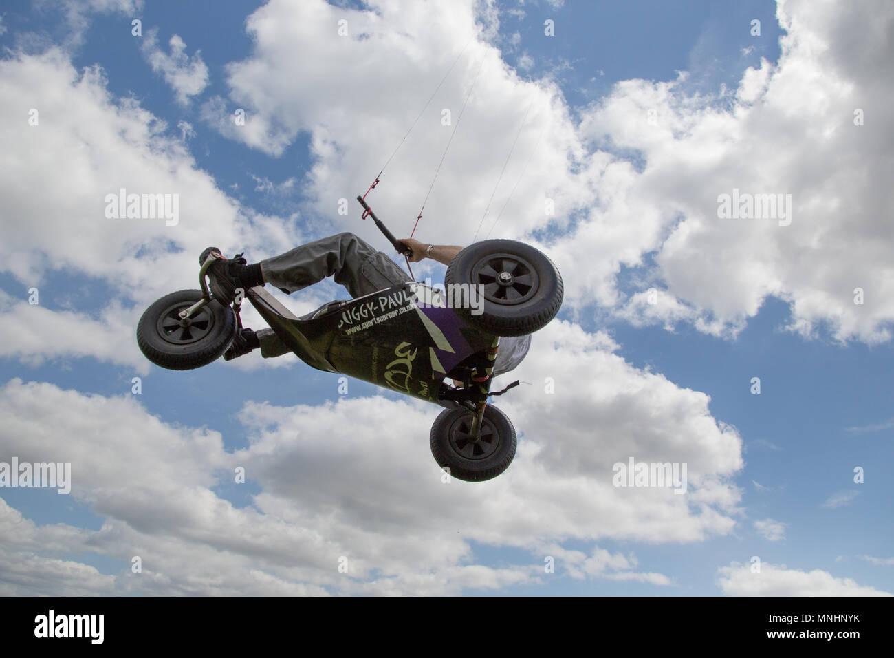 Extreme sport kite landboarding in Essex, UK. Airborne in a land buggy. - Stock Image