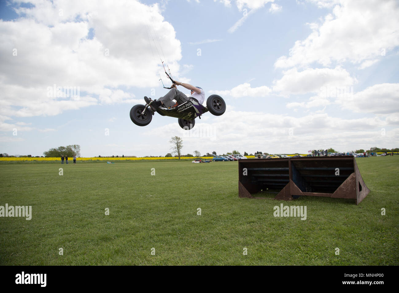 Extreme sport kite landboarding in Essex, UK. Going airborne in a buggy. - Stock Image