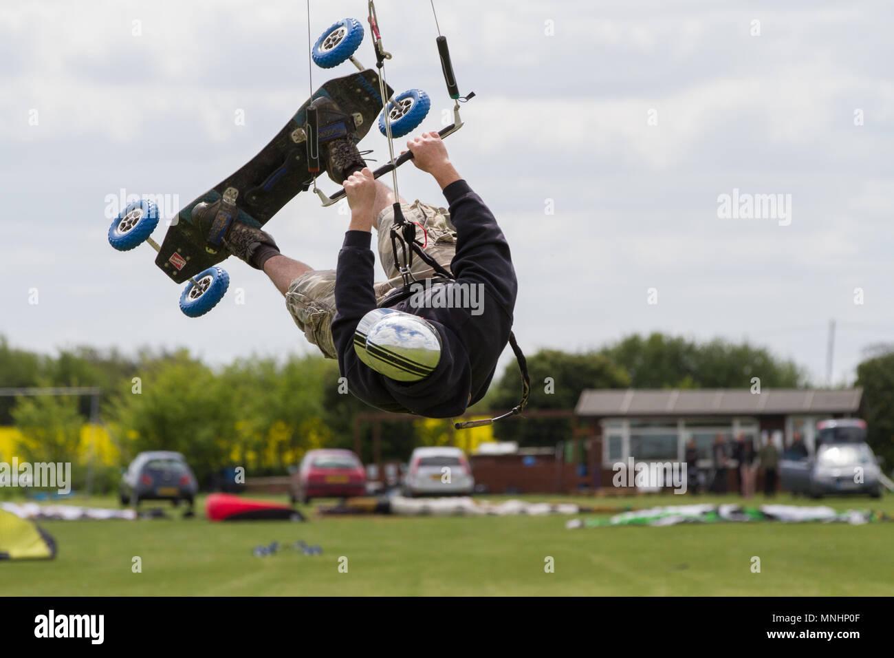 Extreme sport kite landboarding in Essex, UK. Upside down whilst airborne. Stock Photo