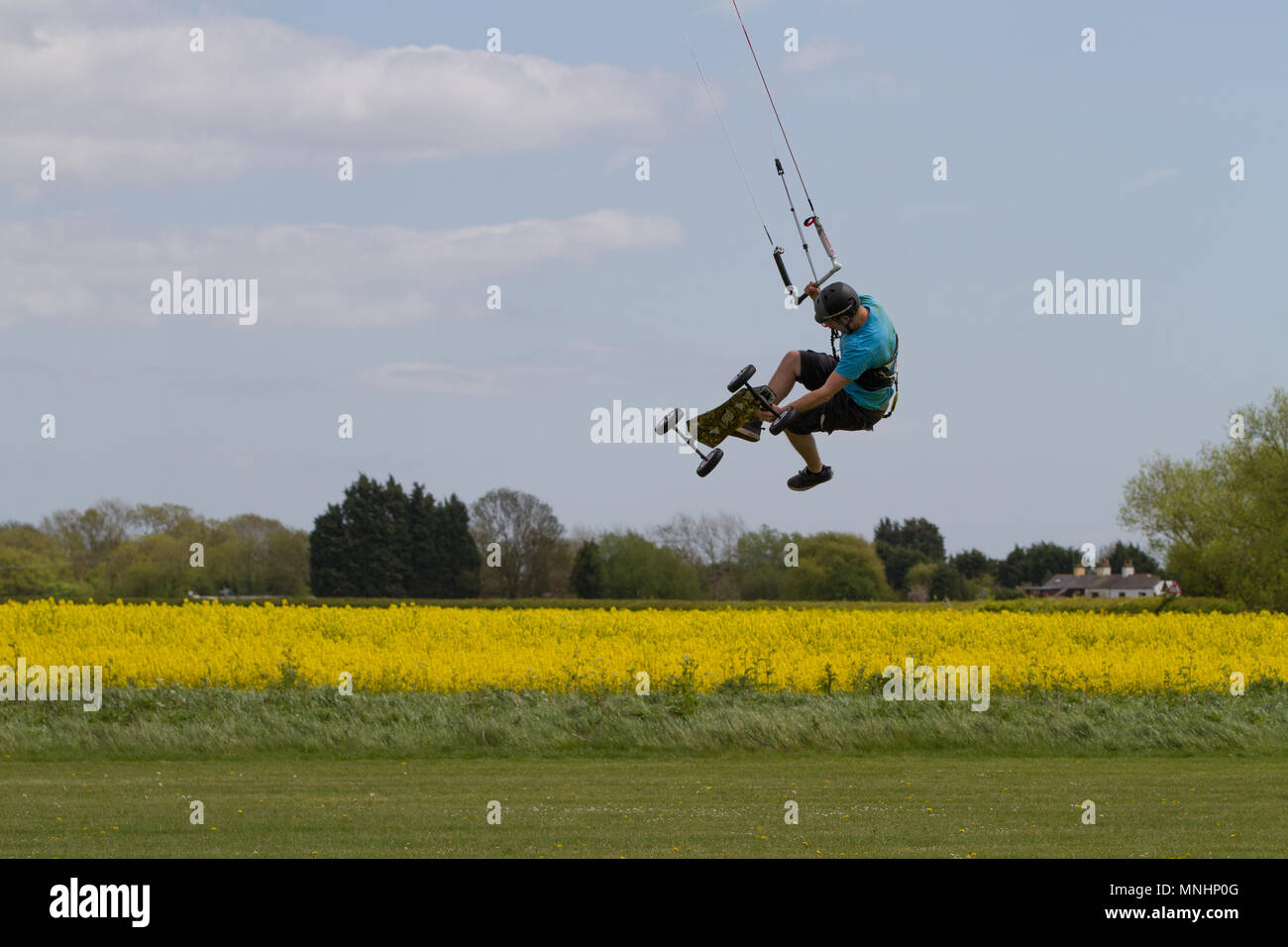 Extreme sport kite landboarding in Essex, UK. Airborne over a field. Stock Photo
