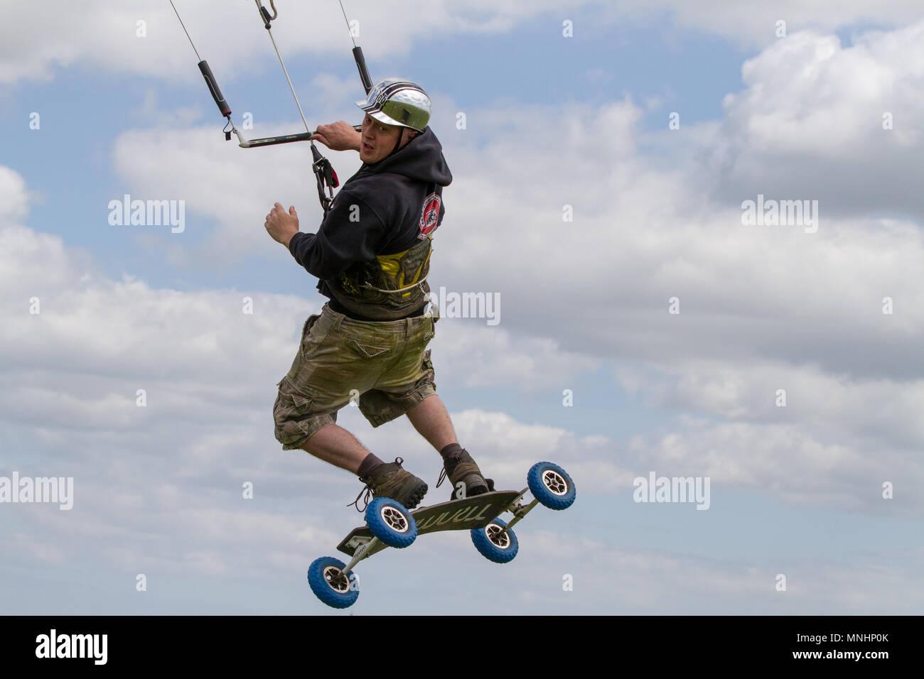 Extreme sport kite landboarding in Essex, UK. Airborne. - Stock Image