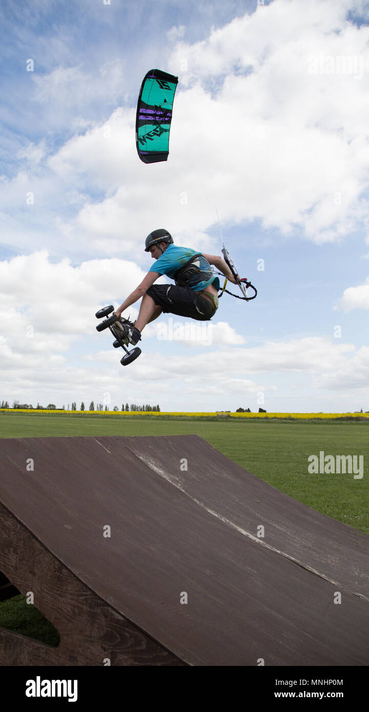 Extreme sport kite landboarding in Essex, UK. Going airborne after a jump. - Stock Image