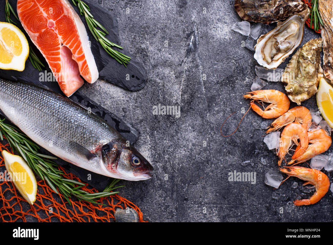 Seafood concept. Fish, shrimps and oysters. - Stock Image