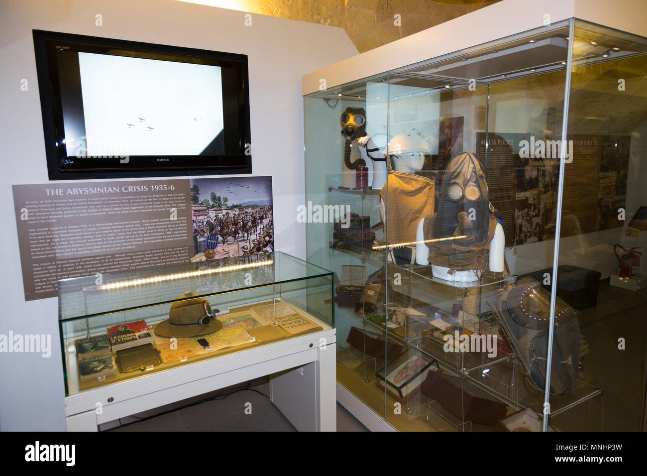 Exhibit / display of exhibits inside room in the exhibition displayed at The Malta At War Museum, Malta. (91) - Stock Image