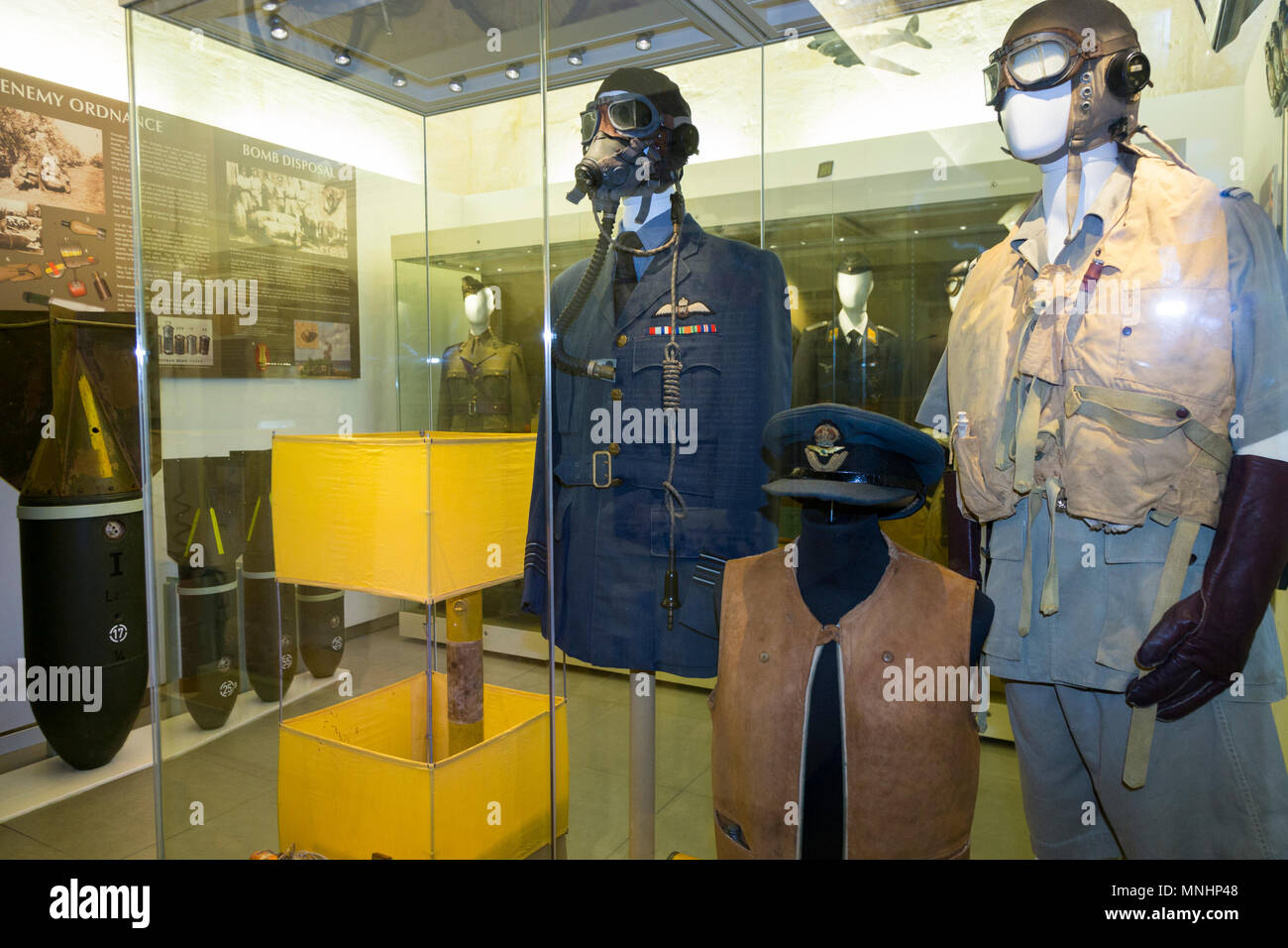 Exhibit / display of exhibits including RAF Allied Air Force military uniform inside the exhibition displayed at The Malta At War Museum, Malta. (91) - Stock Image