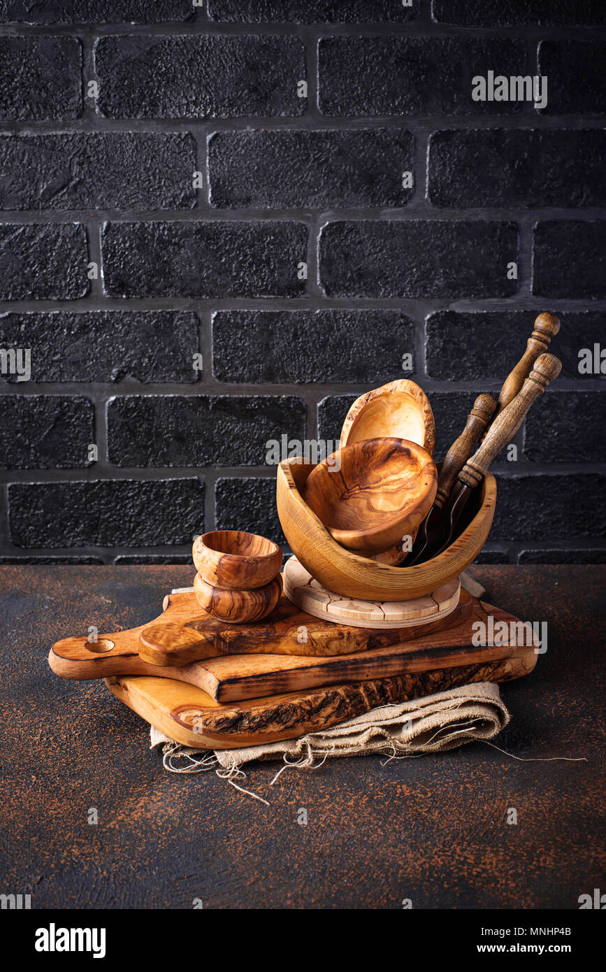 Wooden dishes on a brick wall background - Stock Image