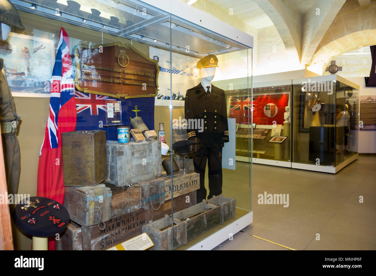 Exhibit / display of exhibits including military uniform inside the exhibition displayed at The Malta At War Museum, Malta. (91) - Stock Image
