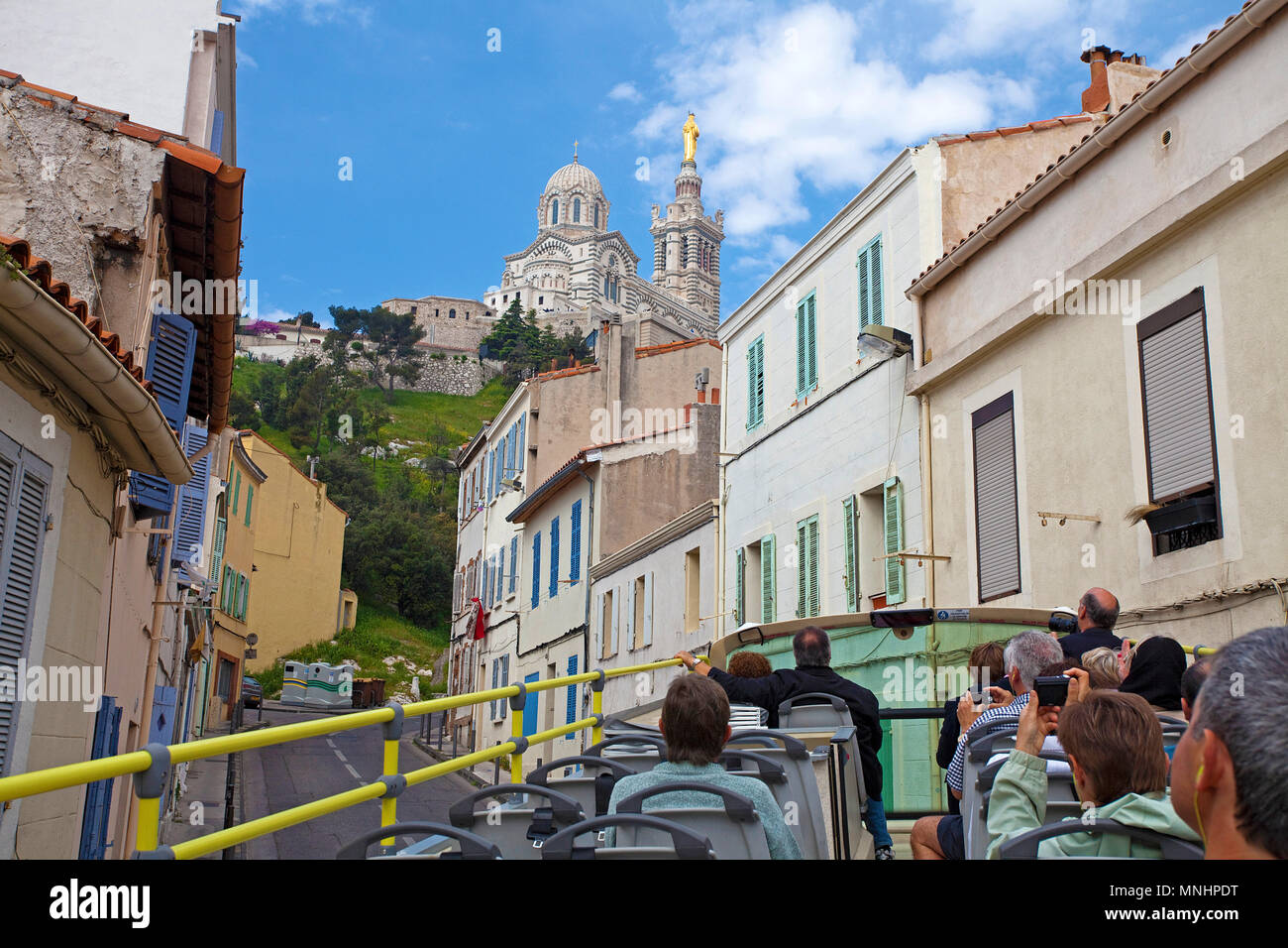 City tour, tourist bus on the way to Cathedral of Notre-Dame de la Garde, Marseille, Bouches-du-Rhone, South France, France, Europe - Stock Image