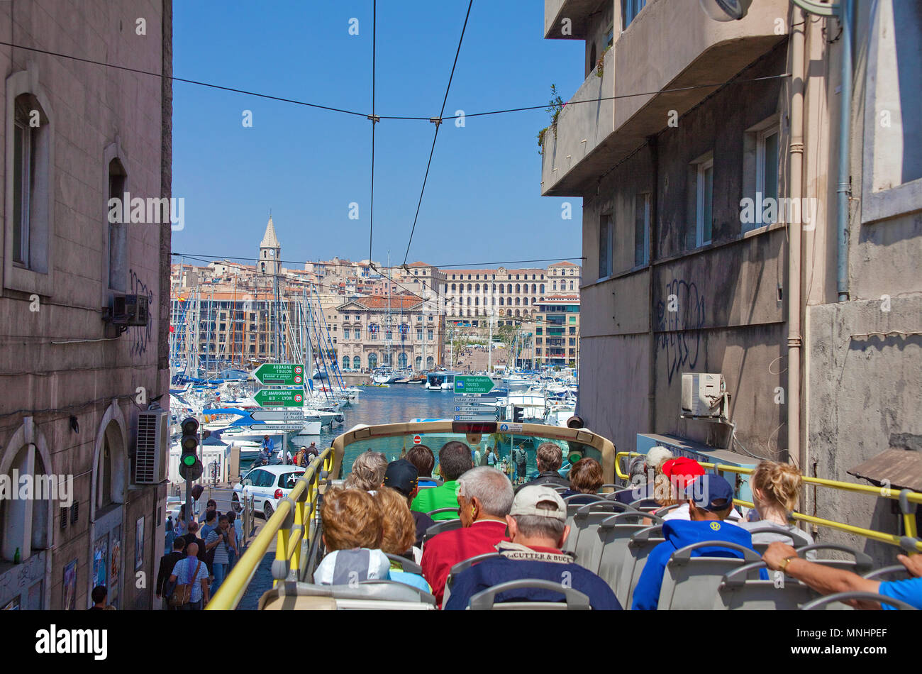 City tour, tourist in bus driving at narrow alley to the old harbour Vieux Port, Marseille, Bouches-du-Rhone, Provence-Alpes-Côte d'Azur, France - Stock Image