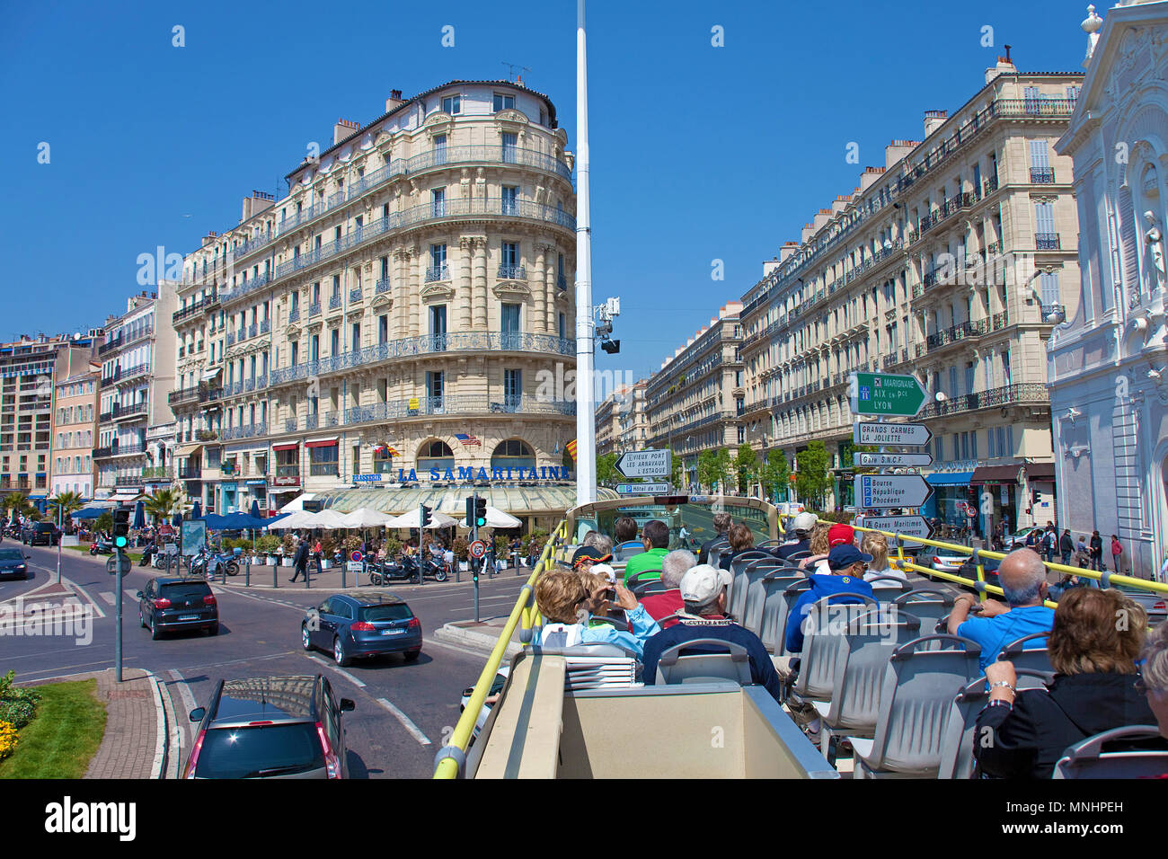 City tour, bus with tourists at Quai du port with restaurant La Samaritaine at the old harbour Vieux Port, Marseille, Bouches-du-Rhone, France - Stock Image