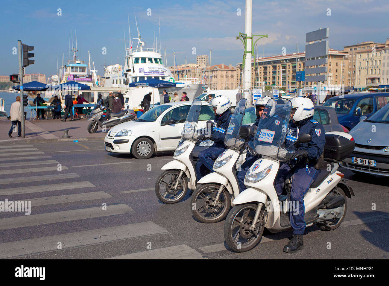 Police men on motor bikes at the harbour of Marseille, Bouches-du-Rhone, Provence-Alpes-Côte d'Azur, South France, France, Europe - Stock Image