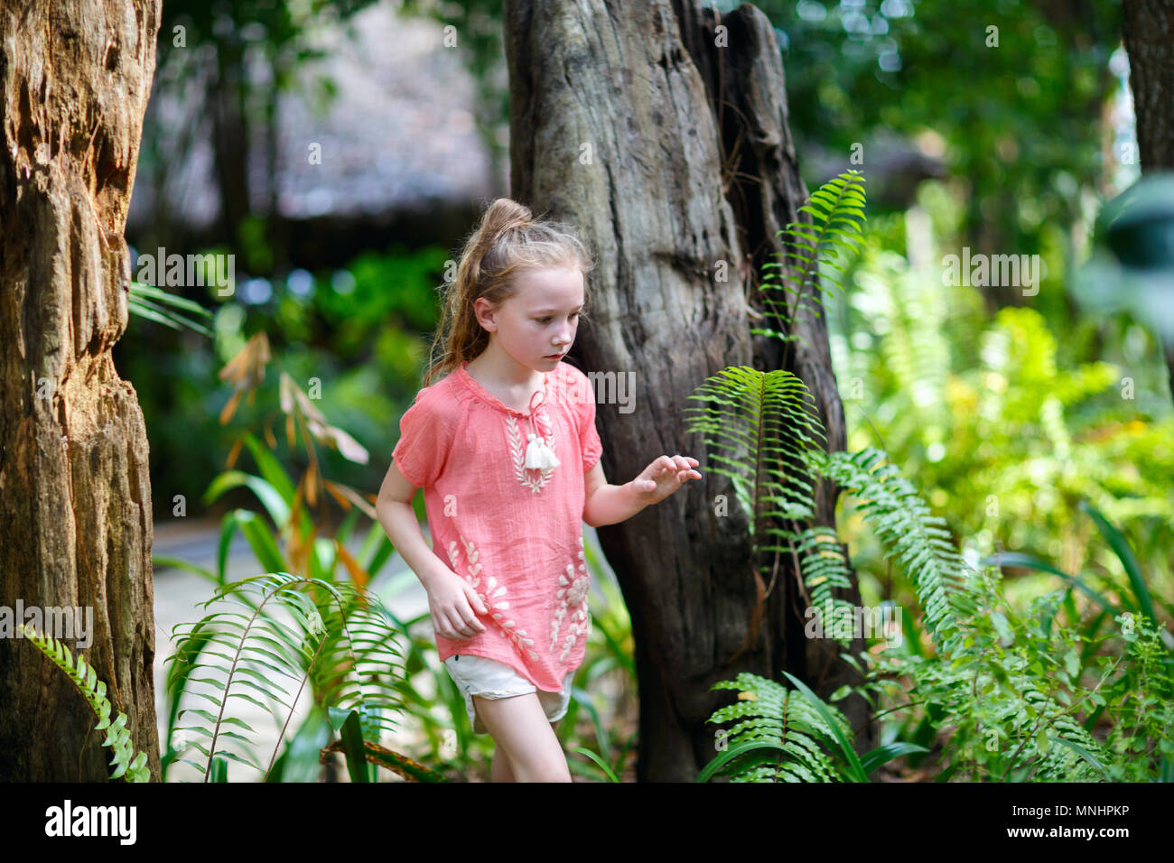 Casual portrait of little girl outdoors on summer day - Stock Image
