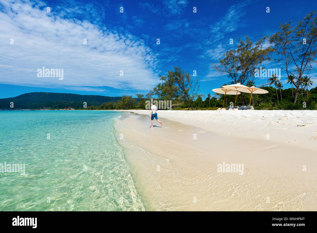 Cute teenage boy at beach during summer vacation - Stock Image