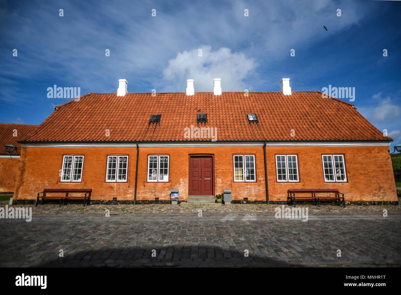 Buildings of Kronborg castle in Denmark, a red brick building. - Stock Image