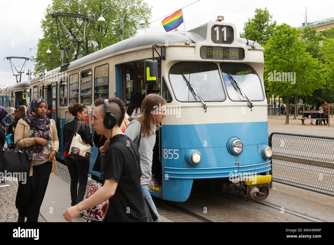 Gothneburg, Sweden - May 28, 2013: Tram on route 11 at stop  decorated with a rainbow flag during the West pride event - Stock Image