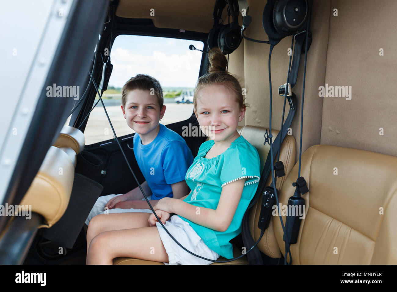 Kids at cabin of helicopter before scenic flight - Stock Image