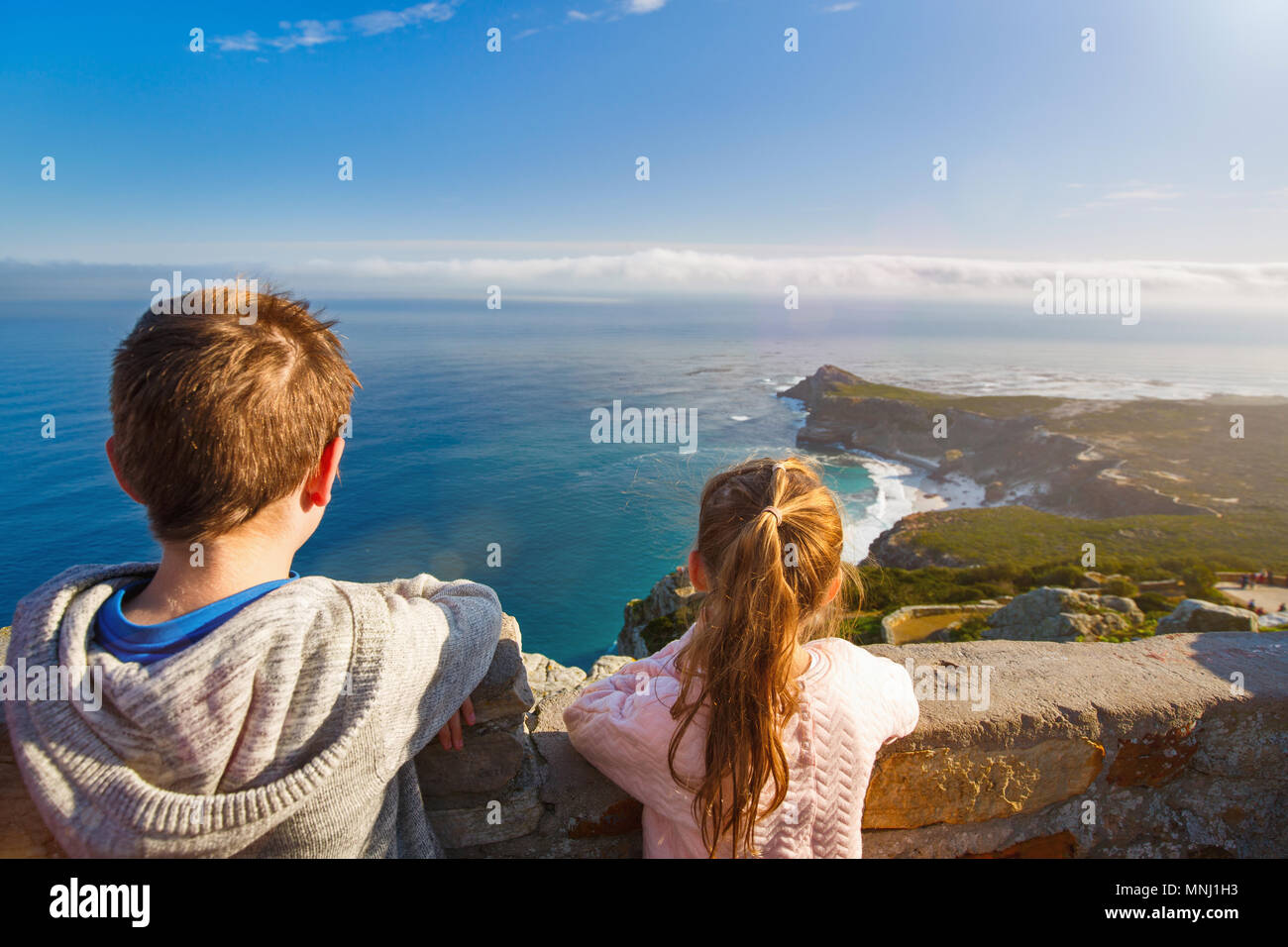 Two kids enjoying breathtaking views of Cape Town from top of Table mountain - Stock Image