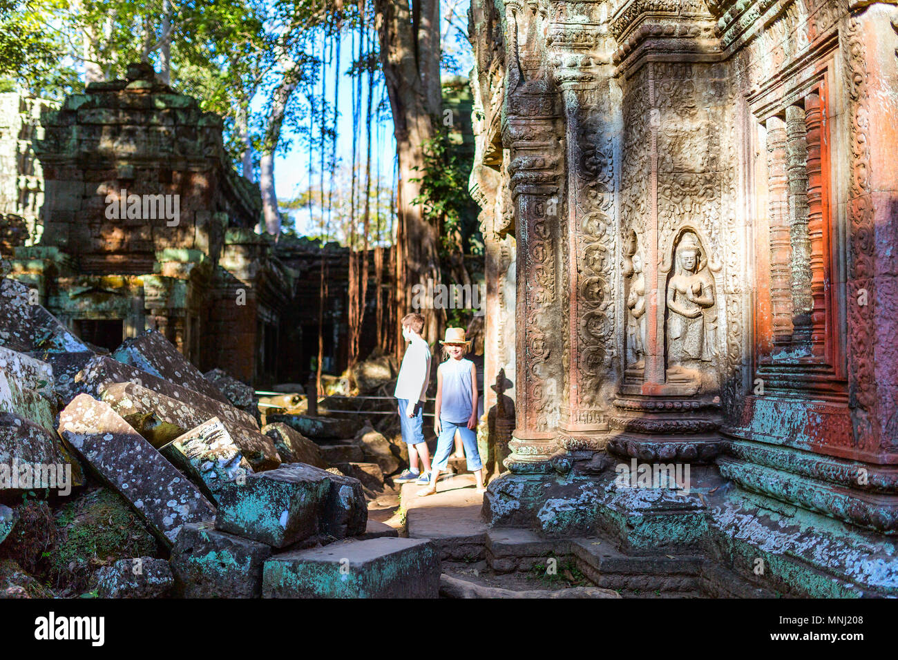 Kids at ancient Angkor temple complex in Siem Reap in Cambodia - Stock Image