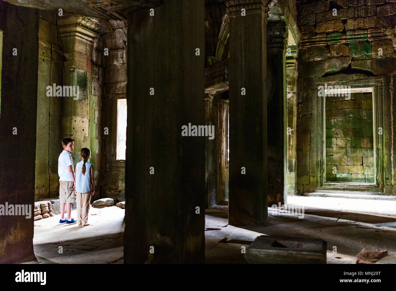Kids at ancient Angkor Wat temple in Siem Reap in Cambodia - Stock Image