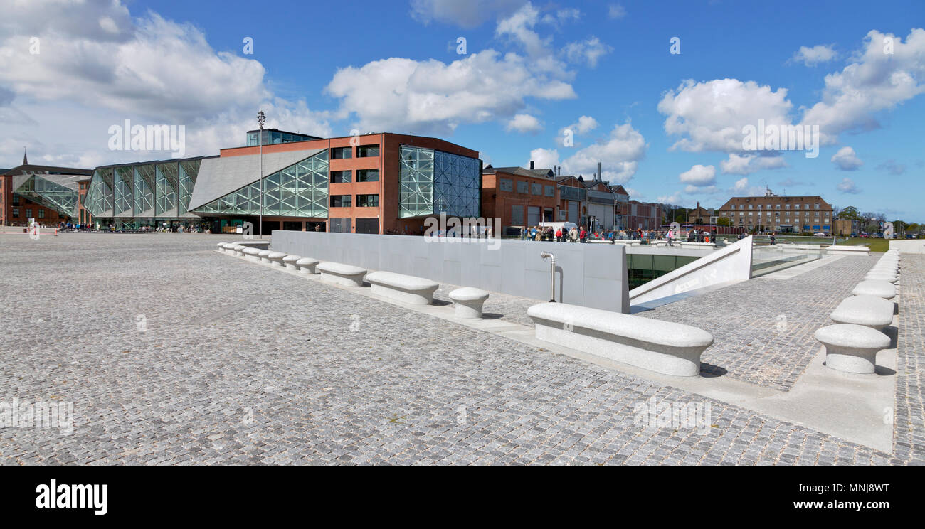 The underground Danish Maritime Museum next to the Culture Yard in Elsinore / Helsingør, Denmark. Bollards around the museum signal a morse code. - Stock Image