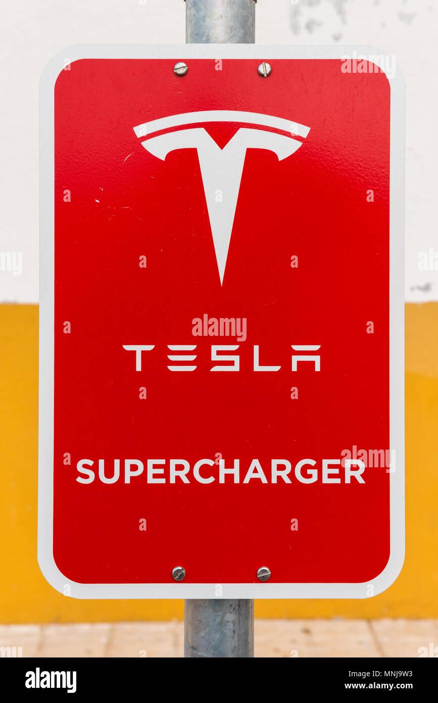Tesla logo stock photos tesla logo stock images alamy for Electric motor shop near me